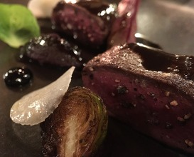 "Roasted roe deer fillet, red cabbage juice ""mondeuse"" and blueberry vinegar"