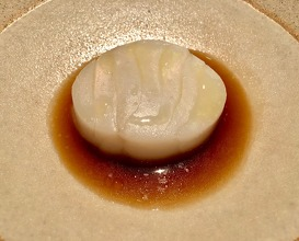 Arctic cod gently steamed with salted butter sauce of smoked scallop roe and fermented celeriac