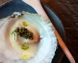 Belon oyster with caviar and fermented white asparagus sauce and cold pressed nori oil