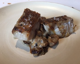 Roasted grouper with wild mushrooms and hazelnut butter dressing