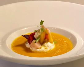 "Carrot soup, ricotta cheese ""in salvietta"" sweet and sour vegetables and roots"