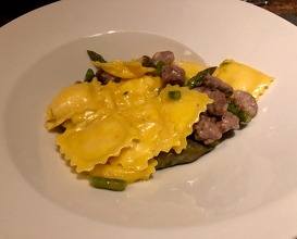 "Cheese fondue ""agnolotti"" with sausage and asparagus"