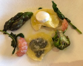 Black truffle ravioli with prawns and violet asparagus