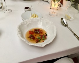 Chilled consome of smoked tomatoes & basil with marinated tuna, plankton and rosehip