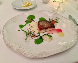 "Wild sea bass with smoked eel ""pil-pil"", fresh herb chlorophyll, samphire & grapefruit"
