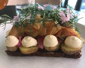 New potatoes with smoked mayonnaise, pickled pineshoots, chips and herbs