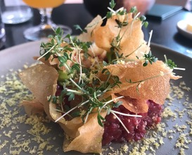 Beef tartare with smoked beetroot, cured egg yolk, lovage mayonnaise and crispy potatoe flakes