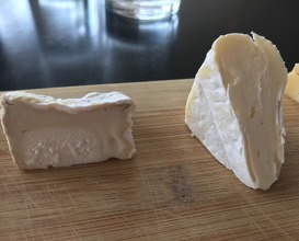 Selection of cheeses with flat bread and honey
