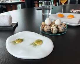 Quail egg with wild garlic, tartelette with yoghurt and char caviar