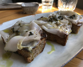 Garlic bread, pickled ramson and lardo of Cinta Senese