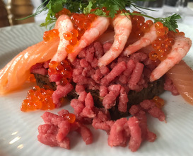 Beef tatare with smoked salmon, fish roe and shrimps
