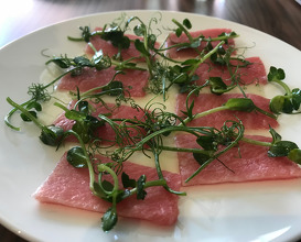 Raw tuna belly, white asparagus juice & pea shoots