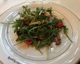 Paillard of veal with rocket, cherry tomatoes and parmesan