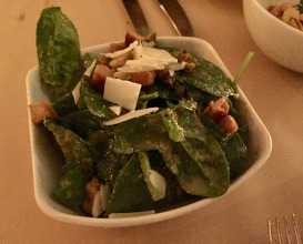 Spinach salad with pecorino and caper