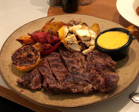 Beef rump steak served with sautéed potato and sweet potato wedges with leek, chorizo and goat cheese, bearnaise sauce.