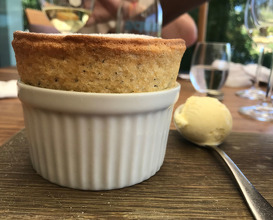 Honey and poppy seed soufflé, crème anglaise and vanilla ice cream