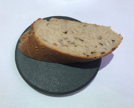 Caraway sour dough, home churned butter, sesame and roasted yeast