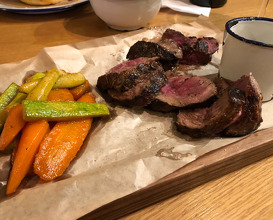 Beef flank steak, marinated with orange and spices and cooked with herbal butter and garlic, sautéed zucchini, carrot and chilli and chimichurri sauce