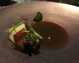 Kuro Awabi black abalone poached in sake, seaweed and daikon, served with aubergine puree, diced grapefruit, spanish air dried beef and abalone liver puree, aubergine soup