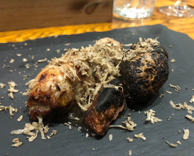 Quail leg cooked on hot stones with black truffles from the Bulgarian forests on top