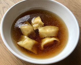 Chicken broth with ravioli