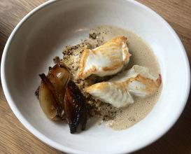 Catfish with quinoa and baked garlic sauce