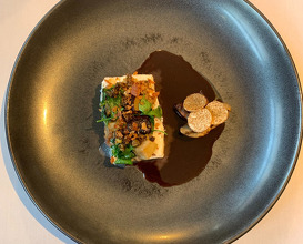 From 9kg turbot, girolles & mousseron served with turbot head brawn, pistacio oil