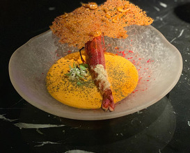 CHUPE OF CARABINEROS With rocoto pepper, maracuyá and Peruvian corn.
