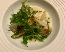 grilled cabbage and artichoke on sunflower seeds risotto