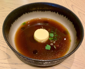 GRILLED WINTER MELON SOUP Egg-soymilk tofu, Coriander oil, Herbs