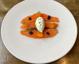 Gin and citrus cured salmon with dill cream and buckwheat blinis