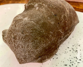 Bread with natural yeast and active charcoal from eggplant. The butter is made from the same charcoal and with the fish oil of belted bonito (Garum).