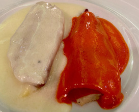 Poached fillet from Sea Bass with white wine sauce and green cheese and roasted pepper cream with the remaining hour of the fish with pepper sauce confit onions and olive oil