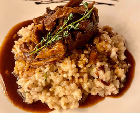 Slow cooked lamb with risotto and mushrooms