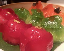Trinity supreme dim sum platter: Royal king crab jade dumpling, Black truffle & Dover sole dumpling