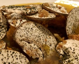 Foie gras poached in sea urchin jus w dates, mushrooms from Savoie with the taste of the sea
