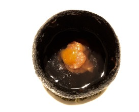 Beneath the sea urchin, veal tartare is then marinated in the urchin juice falling through the hole
