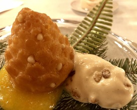 Pomme de pin like a baba, with orange syrup and pine nuts
