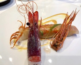 Service of different parts of prawns with infused prawn rice