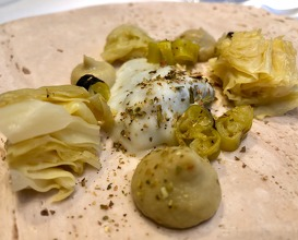 Amélie Esmerald oyster with fermented cabbage and smoked piparra