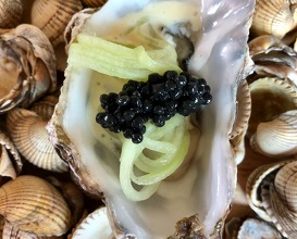 Oysters with home made chorizo and cucumber with caviar