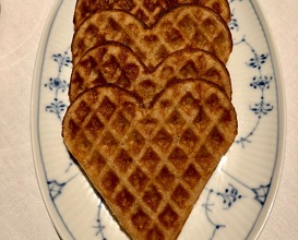 Warm Norwegian waffles made with beef fat and Koji grains, brown cheese, preserved berries and whipped rømme