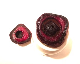 Small birchgrilled beet in a bigger beet, oxtail fat and black currant