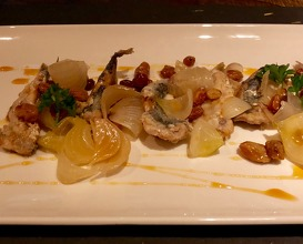 Sweet and sour sardines with white onions, raisins and passito