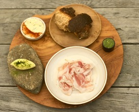 Sourdough bread - ruccola pesto - algae butter - North Sea fish salad - pancetta