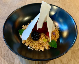Cheesecake, forest fruit syrup, biscuit Icecream, almond paper