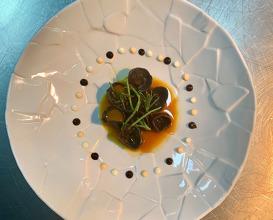 Manti Squid ink, seafood stuffing, shrimp bisque, yogurt trio, sea beans, glasswort, sundried mint